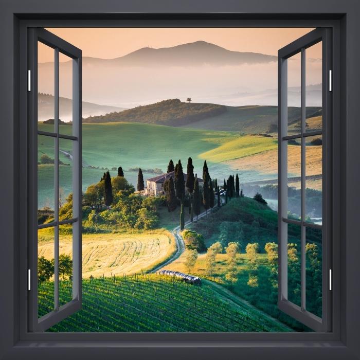 Fototapeta winylowa Okno czarne otwarte - Toskania - Widok przez okno