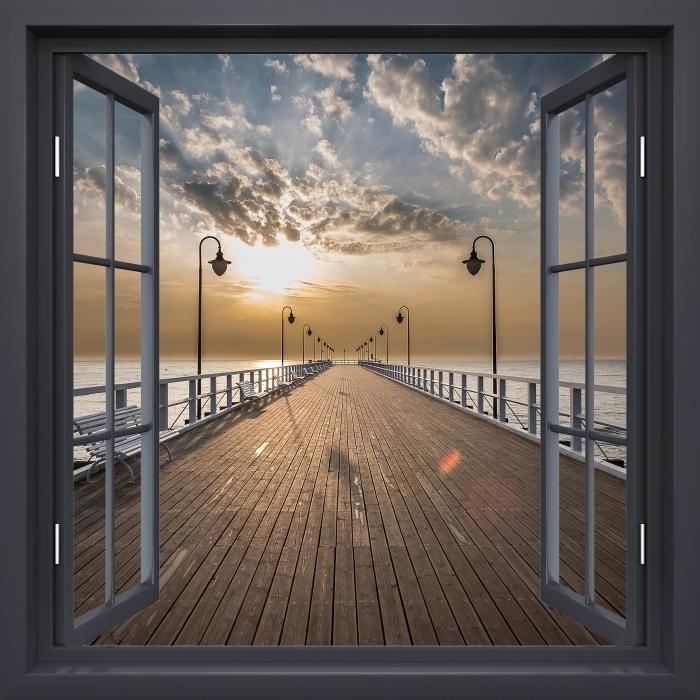Fototapeta winylowa Okno czarne otwarte - Wschód słońca na molo - Widok przez okno