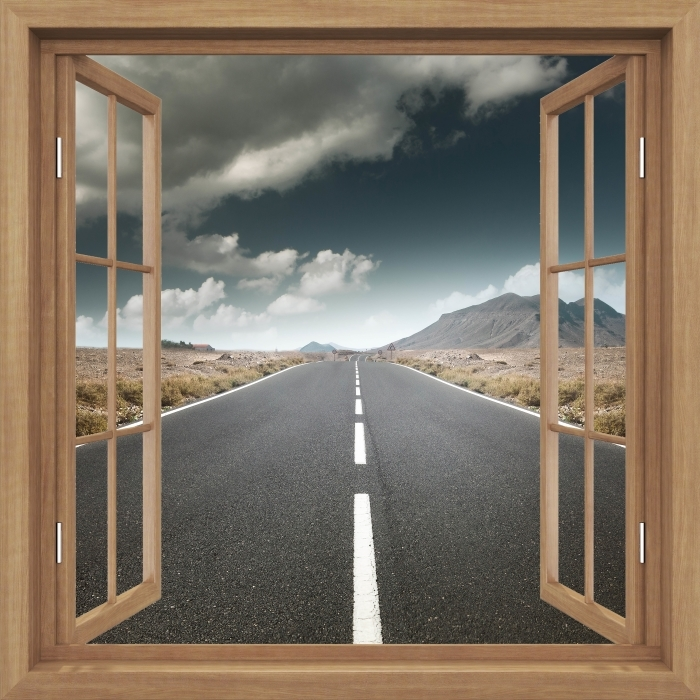 Fototapeta winylowa Okno brązowe otwarte - Droga przez pustynię. - Widok przez okno