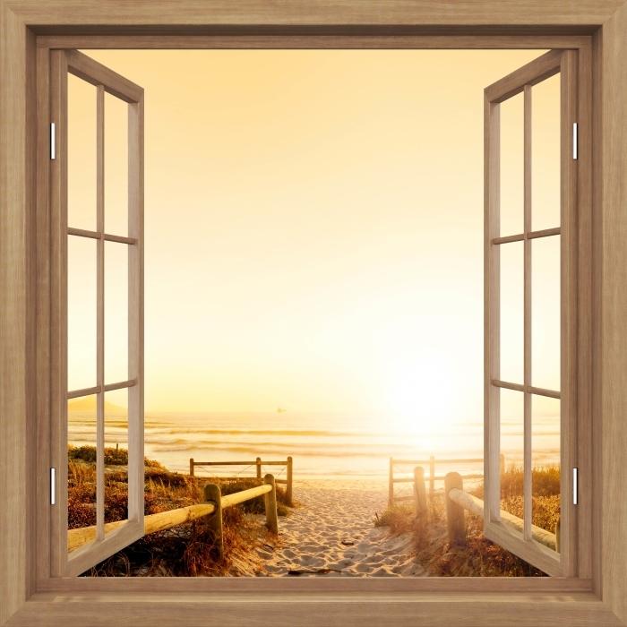 Fototapeta winylowa Okno brązowe otwarte - Zachód słońca nad oceanem. - Widok przez okno