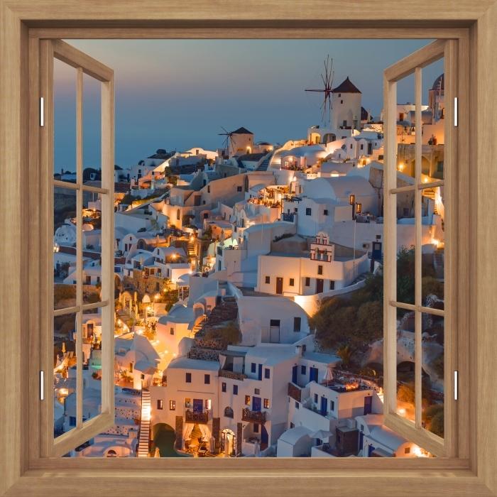 Fototapeta winylowa Okno brązowe otwarte - Piękny zachód słońca w Oia - Widok przez okno
