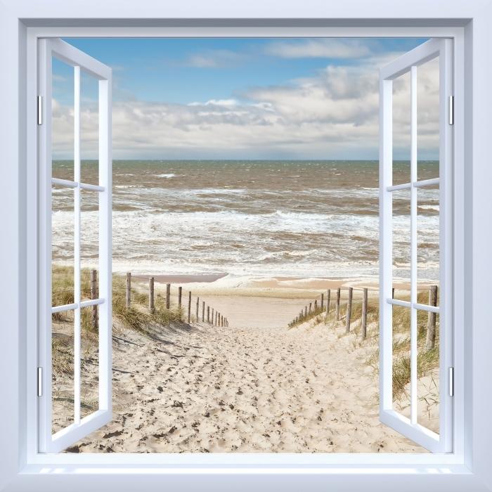 Fototapeta samoprzylepna Okno białe otwarte - Piasek na plaży w słoneczny dzień - Widok przez okno