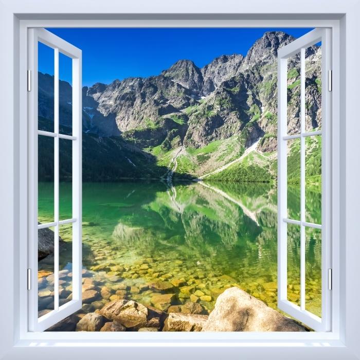 Fototapeta winylowa Okno białe otwarte - Jezioro w górach - Widok przez okno