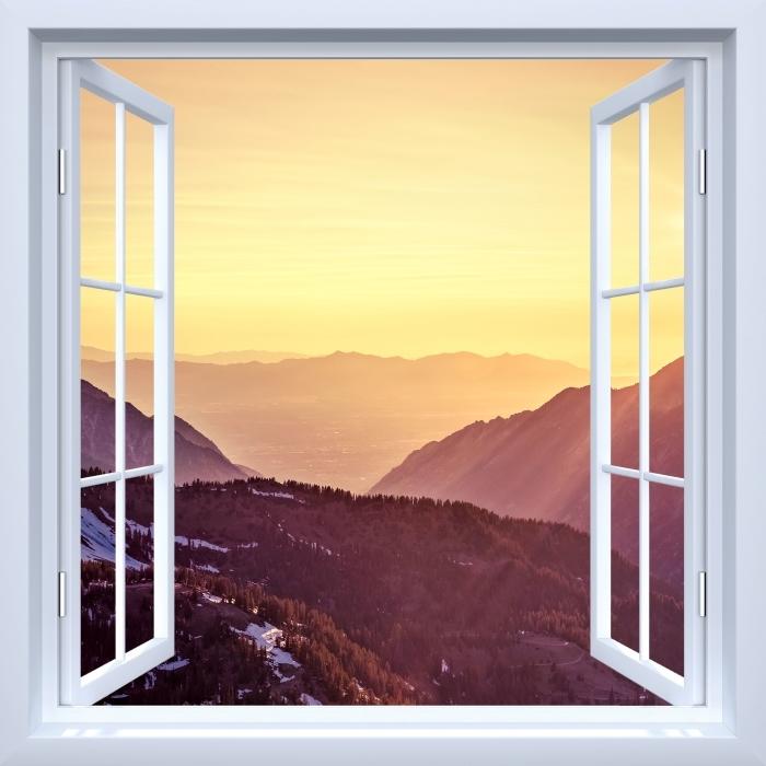 Fototapeta winylowa Okno białe otwarte - Zachód słońca w górach - Widok przez okno