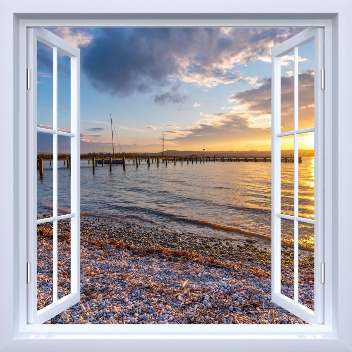 Papier peint vinyle Fenêtre ouverte blanche - Mara - La vue à travers la fenêtre