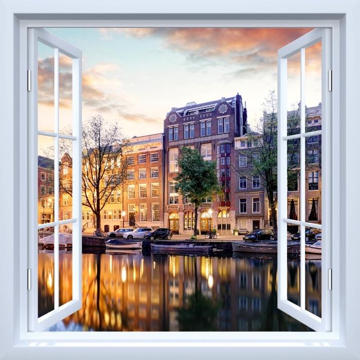 Papier peint vinyle Fenêtre ouverte blanche - Amsterdam. Pays-Bas. - La vue à travers la fenêtre