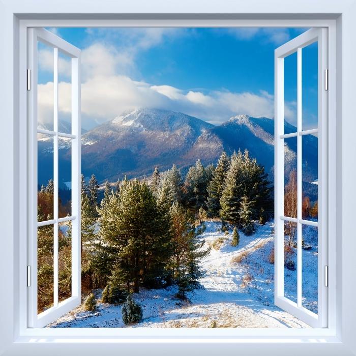 Papier peint vinyle Fenêtre ouverte blanche - Paysage enneigé - La vue à travers la fenêtre