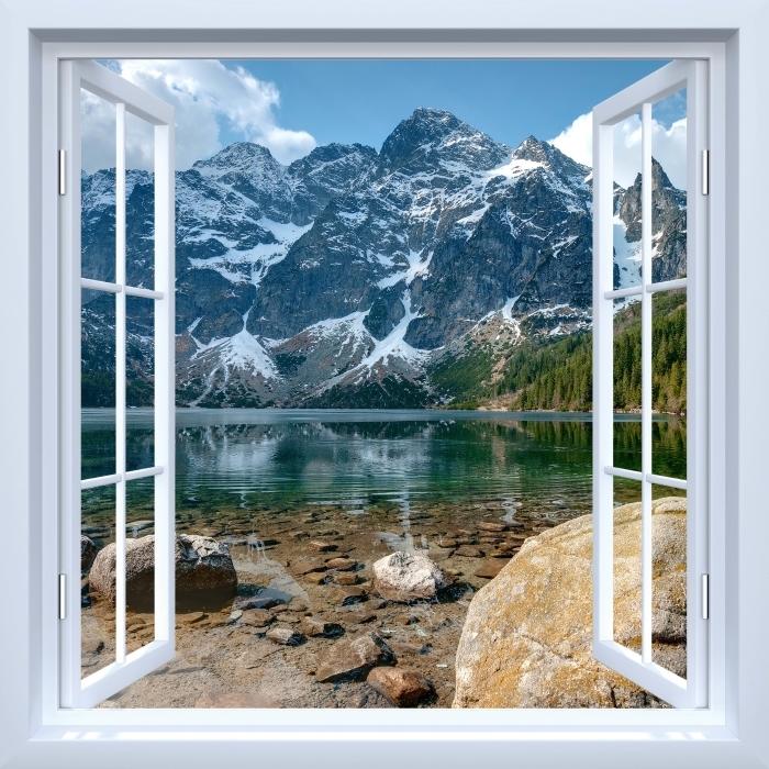 Papier peint vinyle Fenêtre ouverte blanche - Sea Eye. Montagnes Tatra. Pologne. - La vue à travers la fenêtre