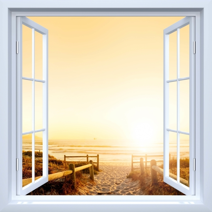 Fototapeta winylowa Okno białe otwarte - Zachód słońca nad oceanem. - Widok przez okno