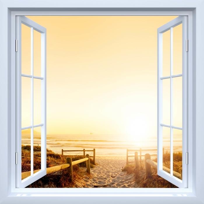 Papier peint vinyle Fenêtre ouverte blanche - coucher de soleil sur l'océan. - La vue à travers la fenêtre