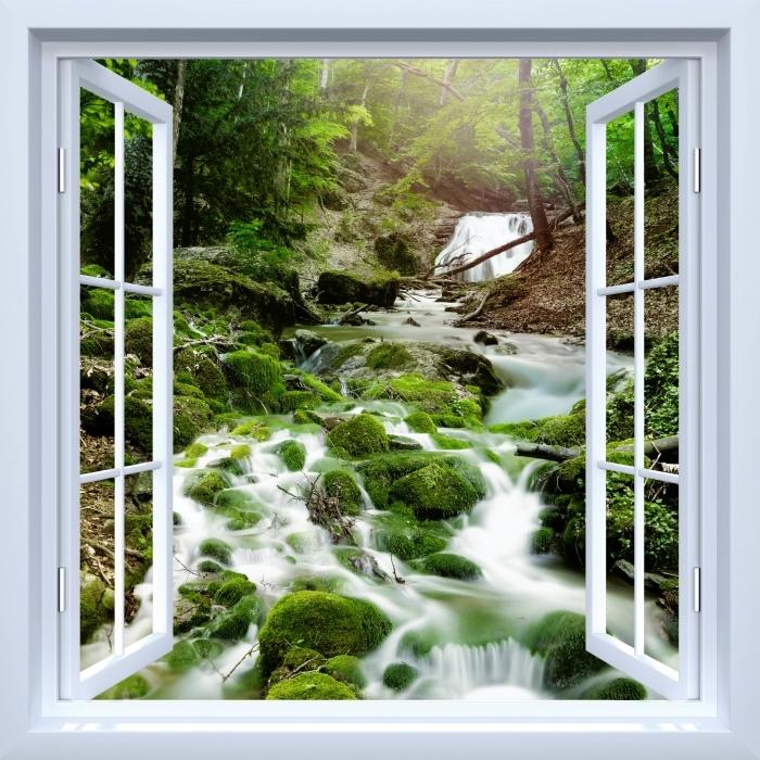 Vinyl-Fototapete Weiß offener Fenster - Wald und Wasserfall - Blick durch das Fenster