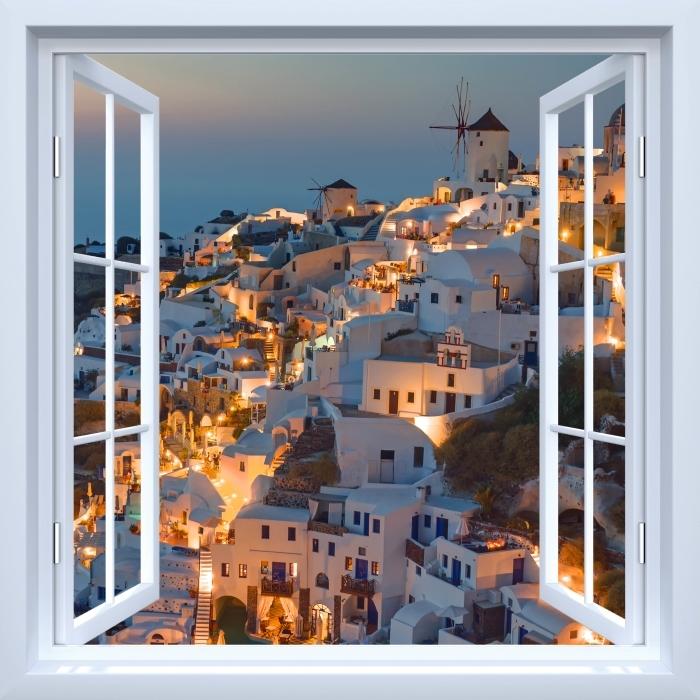 Papier peint vinyle Fenêtre ouverte blanche - Magnifique coucher de soleil à Oia - La vue à travers la fenêtre