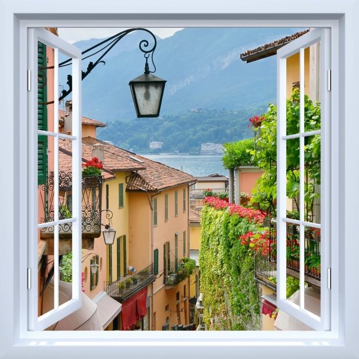 Fototapeta winylowa Okno białe otwarte - Malownicze miasteczko we Włoszech - Widok przez okno
