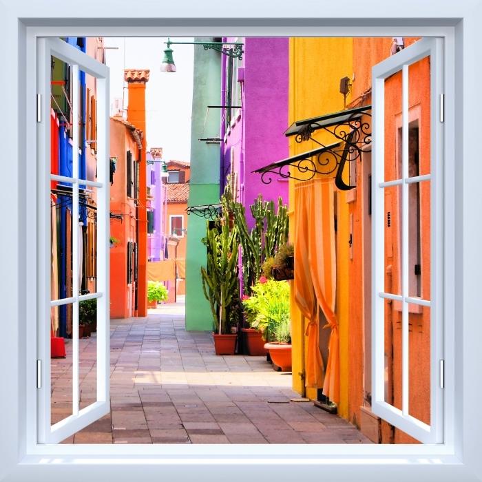 Fototapeta zmywalna Okno białe otwarte - Kolorowa ulica w Burano. Włochy. - Widok przez okno