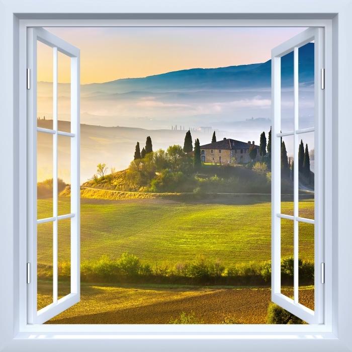 Papier peint vinyle Fenêtre ouverte blanche - Toscane à l'aube - La vue à travers la fenêtre