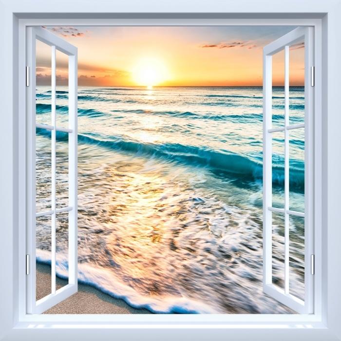 Papier peint vinyle Fenêtre ouverte blanche - Lever de soleil sur la plage - La vue à travers la fenêtre