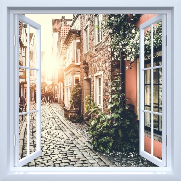 Papier peint vinyle Fenêtre ouverte blanche - vieilles rues - La vue à travers la fenêtre
