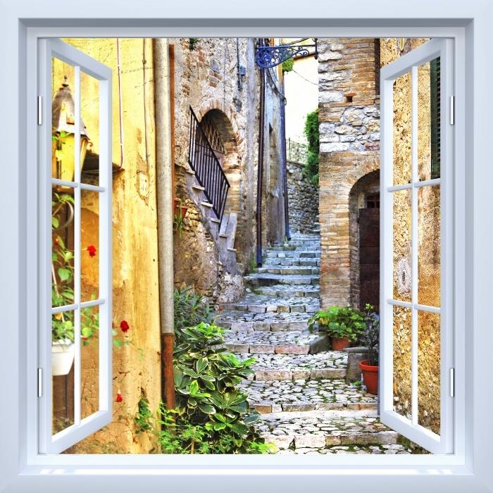 Fototapeta winylowa Okno białe otwarte - Urocze stare uliczki - Widok przez okno