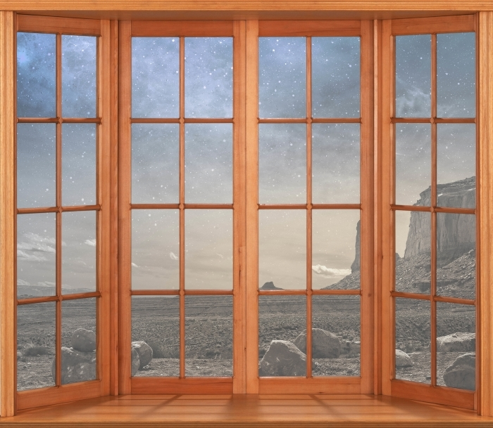 Fototapeta winylowa Taras - Skalista pustynia - Widok przez okno