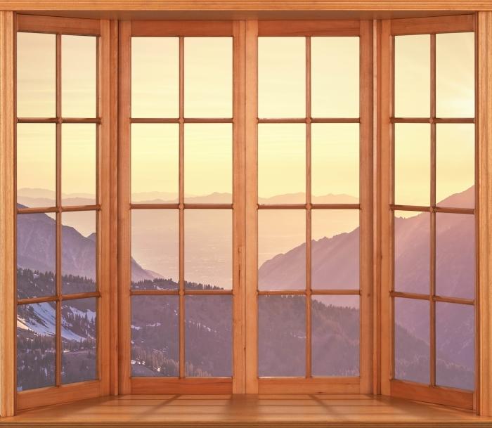 Fototapeta winylowa Taras - Zachód słońca w górach - Widok przez okno