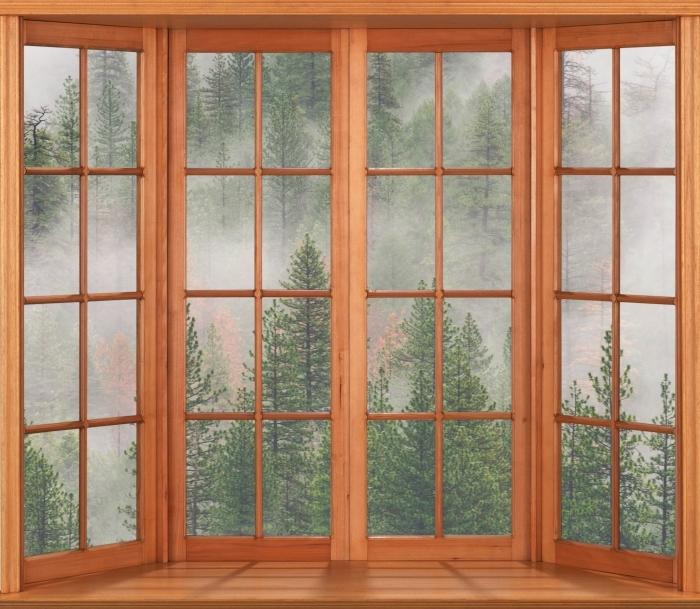 Fototapeta winylowa Taras - Las we mgle - Widok przez okno