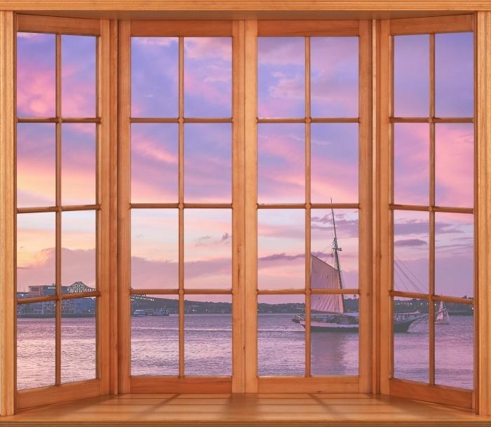 Fototapeta winylowa Taras - Niesamowity zachód słońca w porcie w Bostonie - Widok przez okno