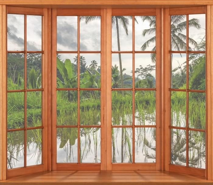 Fototapeta winylowa Taras - Palmy. Indonezja. - Widok przez okno