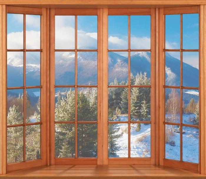 Papier peint vinyle Terrasse - Paysage enneigé - La vue à travers la fenêtre