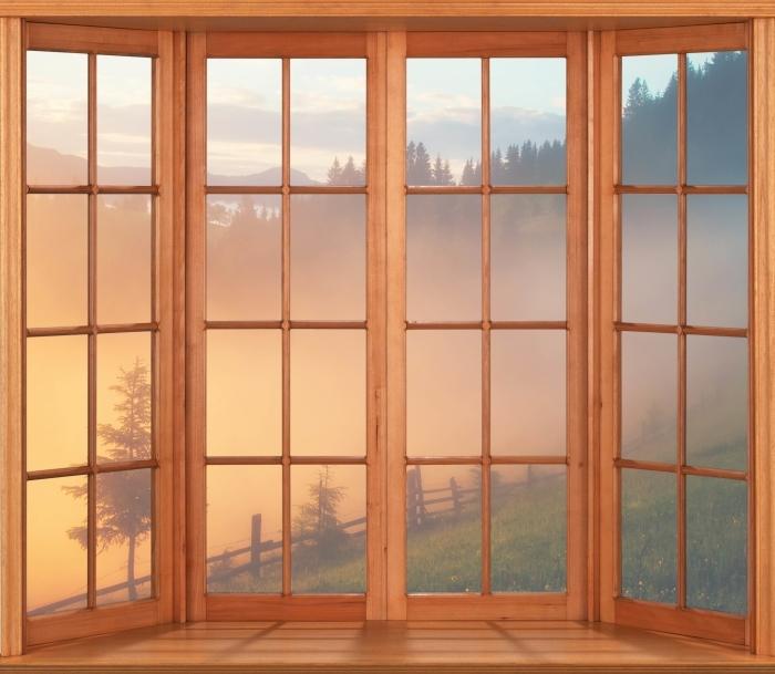 Papier peint vinyle Terrasse - vallée de montagne au lever du soleil - La vue à travers la fenêtre