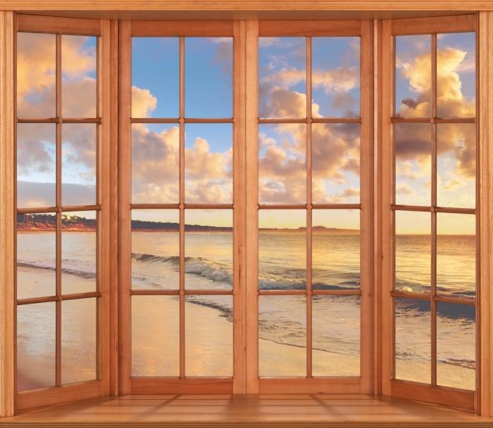 Papier peint vinyle Terrasse - Coucher de soleil sur la plage - La vue à travers la fenêtre