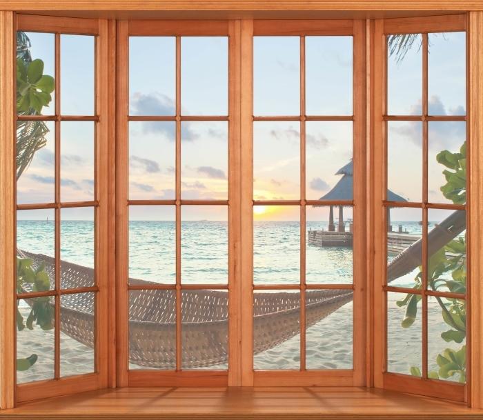 Fototapeta winylowa Taras - Hamak i słońce - Widok przez okno