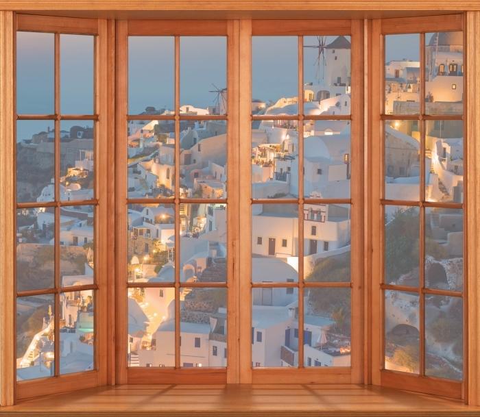 Fototapeta winylowa Taras - Piękny zachód słońca w Oia - Widok przez okno