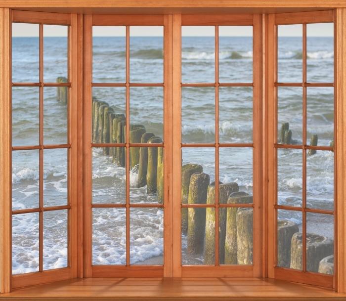 Papier peint vinyle Terrasse - Coucher de soleil sur la mer Baltique - La vue à travers la fenêtre