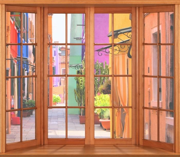Fototapeta winylowa Taras - Kolorowa ulica w Burano. Włochy. - Widok przez okno