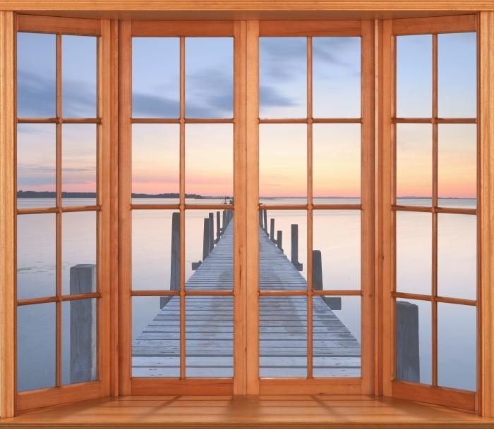 Fototapeta winylowa Taras - Molo - Widok przez okno
