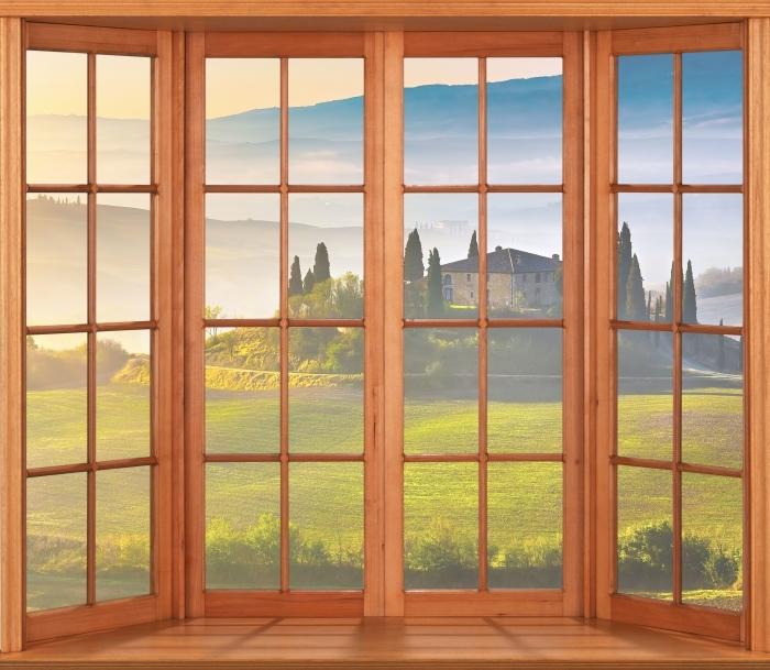 Papier peint vinyle Terrasse - Toscane à l'aube - La vue à travers la fenêtre