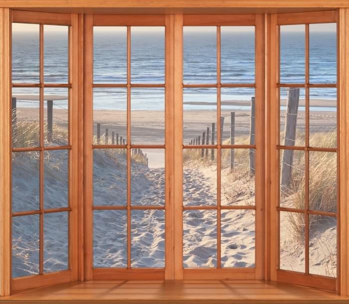 Fototapeta winylowa Taras - Morze Północne - Widok przez okno