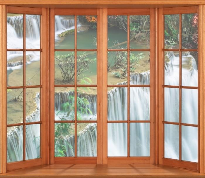 Vinyl-Fototapete Terrasse - Wasserfall im tropischen Wald - Blick durch das Fenster