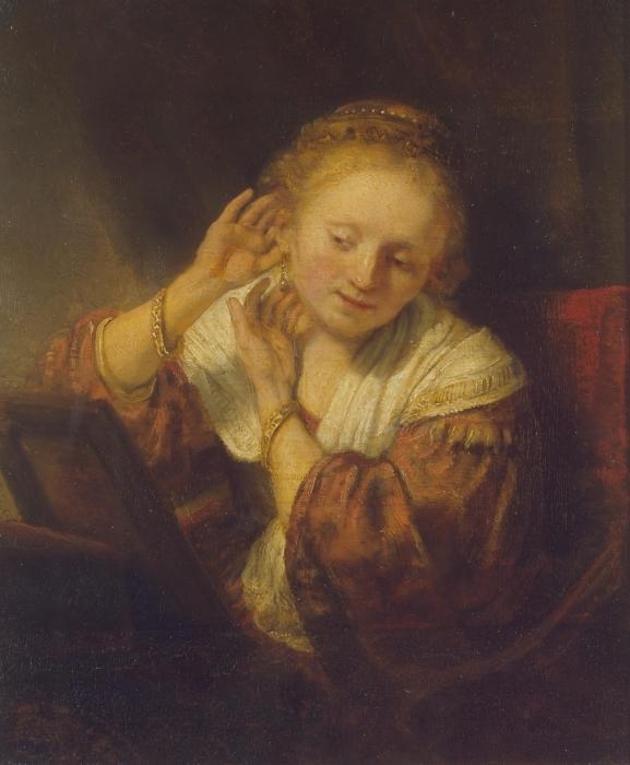 Fotomural Estándar Rembrandt - Mujer joven que intenta en los pendientes - Reproducciones