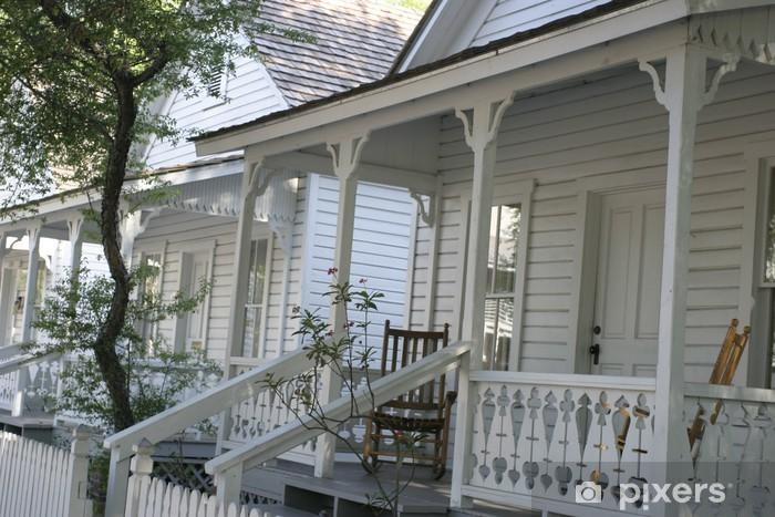 148c47d3d Vinilo Hileras de casas blancas con balcones, artesanía en madera y una silla  mecedora Pixerstick