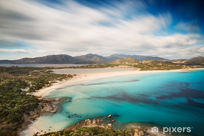 View of a beautiful bay with azure sea from top of a hill, Villasimius, Sardinia island, Italy, with a long exposure to move the clouds and to silk the sea Vinyl Wall Mural - Landscapes