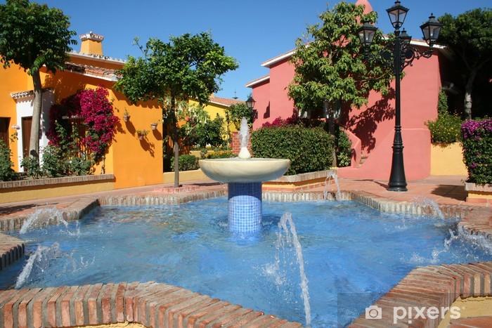 Fototapeta winylowa Słoneczny taras z fontanną, Hiszpania - Wakacje