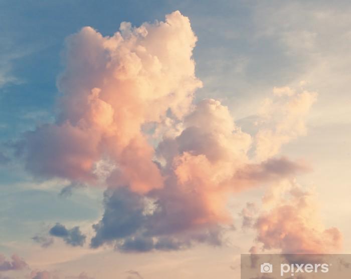 Papier peint vinyle Nuages roses sur un ciel bleu -