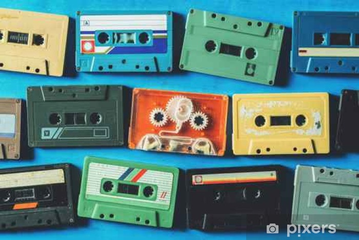 Old cassette tapes on blue wooden table, top view Pixerstick Sticker - Hobbies and Leisure