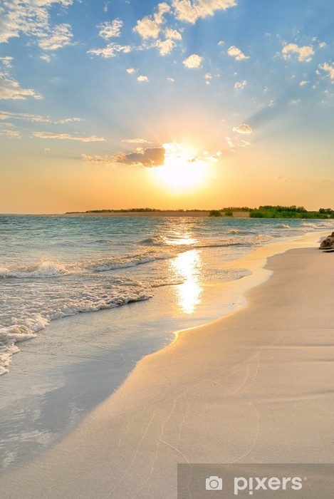 Fototapeta winylowa Spokojnej plaży zachód słońca - Tematy