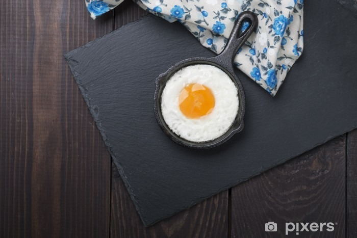 fried egg on a small cocotte black and wooden background Pixerstick Sticker - Food