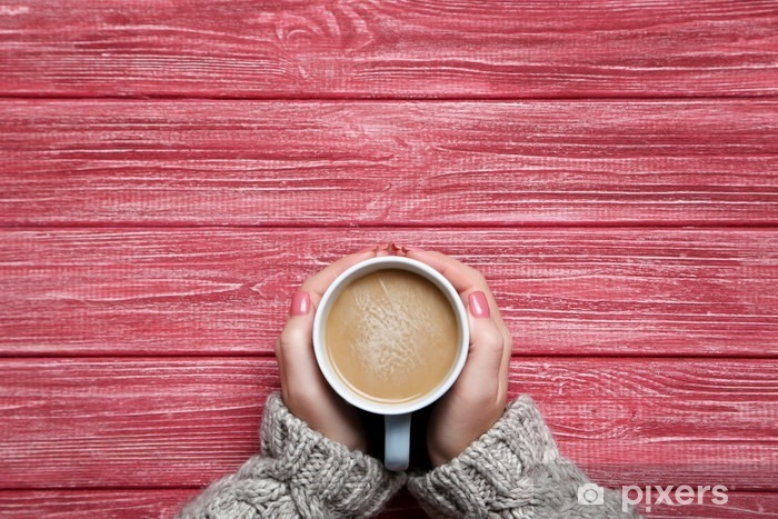 Woman hands holding cup of coffee on wooden table Vinyl Wall Mural - Drinks