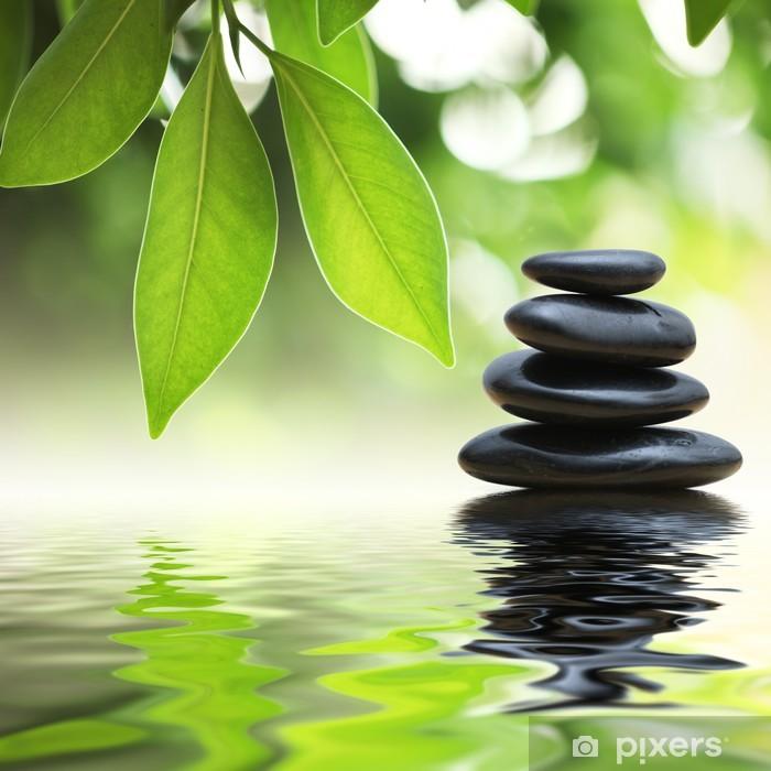 Zen stones pyramid on water surface, green leaves over it Pixerstick Sticker - SPA & Wellness