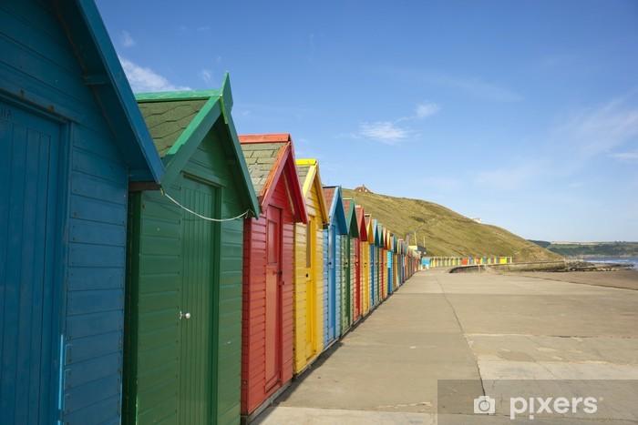 Papier peint vinyle Cabines de plage colorées - Eau