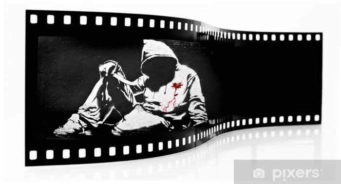 Fototapeta winylowa Banksy Hoodie nożem Graffiti Film Strip - Znaki i symbole